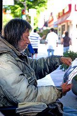 The Homeless Man (Shavar Ross) Tags: california street people man hair paper sadness reading newspaper coat homeless poor read burbank hungry hobo needy hardtimes homelessman recession homelesspeople burbankca shavarrosscom