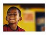boy in yellow (Nachosan) Tags: portrait yellow children bokeh puertorico caribbean nachosan nikonstunninggallery blackribbonicon bokehsoniceaugust bokehsoniceaugust11