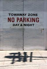 No Parking (O Caritas) Tags: sanfrancisco california shadow sign warning doors noparking july 2006 sidewalk powellstreet towaway nikoncoolpix8800 2006bypatricktpowerallrightsreserved
