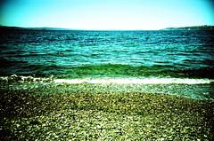crisp (poopoorama) Tags: seattle sky green film beach water washington lomo lca xpro kodak crossprocess alkibeach e6 vignette e100vs