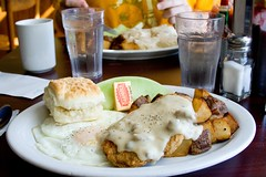 Chicken fried steak & eggs (Heather Leah Kennedy) Tags: food breakfast oregon portland restaurant cafe potatoes honeydew gravy biscuit butter eggs biscuits melon chickenfriedsteak sausagegravy milkgravy bertielous