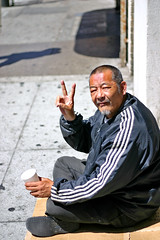 Chinatown Man (Shavar Ross) Tags: life sanfrancisco california street city travel summer people usa man cup america beard sadness goatee chinatown peace homeless poor chinese places 2006 hungry peacesign hobo needy hardtimes recession homelesspeople chinatownman shavarrosscom