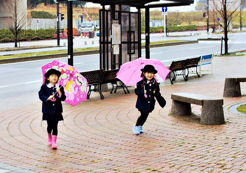 Children and umbrellas by JanneM.