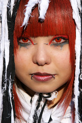 Red and ragged (Lil [Kristen Elsby]) Tags: portrait woman face japan japanese tokyo costume topf75 asia cosplay rags makeup fringe piercing harajuku contacts  topv11111 gaze visualkei eastasia contactlens