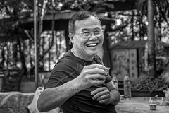 cheers with tea (Dax Ward Photography) Tags: smile cemetery fun thailand happy tea bangkok streetphotography kind elderly cheers karaoke jovial thaipeople thaismile chinesecemetery bangkokstreet bangkokstreetphotography