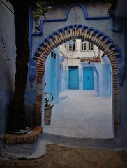 doorway to more doors (SM Tham) Tags: africa morocco rifmountains chefchaouen thebluecity thebluepearl medina oldquarter doorway archway courtyard buildings houses homes doors lightandshadows tree plastercarving blue walls street outdoors
