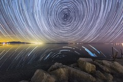 Stars Spin in the Sky Above the Southern Shore of the Salton Sea (slworking2) Tags: starstax startrails nighttime stars astronomy nature sky nightsky saltonsea california lake reflection desert