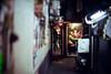 At The Edge of Time and Space (Jon Siegel) Tags: nikon nikkor d810 50mm 12 nikon50mmf12 man men people alleyway time space architecture intimate secret hidden secrets night evening shinjuku tokyo japan japanese