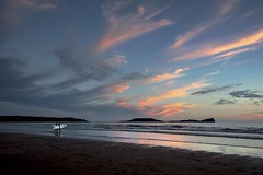 The last surf of the day  explore 11,March 2017 (Jo Evans1 - Off and on for a while) Tags: surfer last surf day worms head rhossili llangennith beach gower pink clouds waves