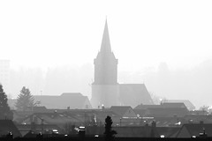 the town church (Wackelaugen) Tags: church steeple town winter mist renningen germany canon eos photo photography wackelaugen black white bw blackwhite blackandwhite mono noiretblanc schwaz weis schwarzweis