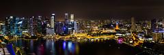 Panorama depuis la terrasse de l' Hôtel Marina Bay Sands (150 m) - Singapour (Erminig Gwenn) Tags: canon canoneos6d canon6d adoblelightroomcc adobelightroom6 lightroom fullfrae pleinformat 24x36 singapour singapore nuit night marinabaysands hotelhôtel nocturne bynight denuit nighty asie asia city town fromabove vuedenhaut panorama signtseeing sight vue view downtown centre center centreville marina rooftop skybar skyline skycraper ckycrapers grattesciel fratteciel lignedhorizon port harbour reflet reflects reflection lights lumières altitude heigh panoramic panoramique