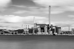 Power Plant, Helsinki (Sunny Herzinger) Tags: chimney bw white plant black clouds canon finland boat helsinki energy ship crane smokestack fi coal 70200 canon70200f4l 6d uusimaa