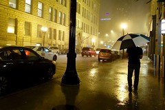 refuge series - the soloist [Explored] (KevinIrvineChi) Tags: road red summer chicago storm reflection green cars car rain silhouette yellow night umbrella blackwhite nightlights shadows purple taxi pedestrian stormy courtyard sidewalk rainy thunderstorm pour stroll pouring refuge deluge rivernorth strolling chicagoist summerstorm sidewalkstories summ rainychicago