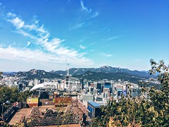 The mountains near Seoul (bengod3) Tags: city travel blue vacation sky urban mountain holiday mountains building beautiful clouds buildings landscape amazing asia cityscape korea seoul blueskies southkorea iphone