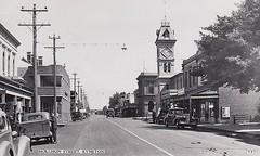 Mollison Street, Kyneton, Victoria - circa 1940s (Aussie~mobs) Tags: cars australia victoria clocktower 1940s shops streetscape automobiles businesses kyneton mollisonstreet