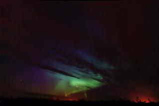 Aurora Through Cloud Gaps