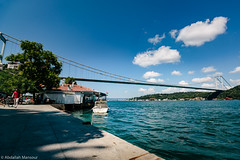 A walk by the Bosphorus (Abdallah A. Mansour) Tags: street bridge sea man water canon turkey landscape geotagged eos boat streetphotography places istanbul hdr bosphorus presets 550d vsco
