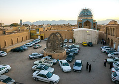 a wooden nakhl on a square filled with cars, Yazd Province, Yazd, Iran (Eric Lafforgue) Tags: city people urban building art cars horizontal architecture religious outdoors town persian worship iran symbol traditional parking religion middleeast persia architectural shia muharram ashura iranian tradition cultural yazd shiite persiangulfstates nakhl smallgroupofpeople   16969 colourimage  iro shiism  yazdprovince westernasia