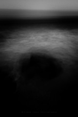 darkness, visible. (~Ventnor~) Tags: longexposure icm abstract sea rocks shore coast blur movement obscure dark darkness wave surf tide tidal waves foam intentional milton turmoil void formless deep depths black mono monochrome