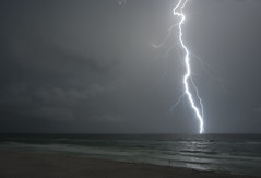 Caught (lightonthewater) Tags: ocean storm beach gulfofmexico clouds sand thunderstorm lightning seagrovebeach