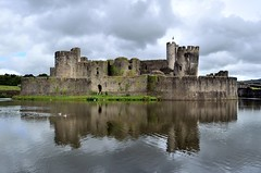 Caerphilly Castle, S Wales (bodythongs) Tags: light sky reflection tower castle heritage water wales architecture de nikon clare south cardiff medieval glamorgan gilbert welsh fortification moat defences cromwell mediaeval castell caerphilly bute caerffili cadw d5100 bodythongs sleightingmarquess