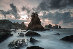 I Didn't Know My Own Strength (MANUELup) Tags: ocean longexposure light sunset sea sky cliff sun seascape luz nature water rock island mar spain quiet cloudy wildlife seagull naturallight calm cielo nubes owl roca acantilado cantabria liencres losurros