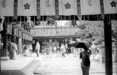 Kitano tenmangu visit (rodrigo.blackburn) Tags: blackandwhite japan umbrella kyoto asia shinto kitanotenmangu japaneseshrine fujiacross100 olympusom2n d7611 nikoncoolscaniv zuiko50mm18