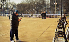 Connected,Disconnected (Robert S. Photography) Tags: boardwalk scene man heaadphones phone benches strolling sitting trees brooklyn brightonbeach coneyisland nyc nikon coolpix l340 iso80 december 2016