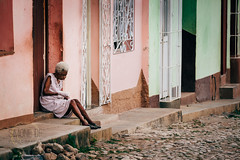 Streets Of Trinidad (Simone Della Fornace) Tags: street streetphotography cuba cuban trinidad old woman sitting candid colorful oneperson cobbled sony a7rii outdoor building reportage journalism photojournalism