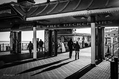 Entrance Shadows 1/52 (amipal) Tags: architecture brighton city england gb greatbritain palacepier pier sea shadow sussex uk unitedkingdom urban water people entrance 52weeksofphotography photoaweek photo52 manuallens voigtlander 175mm