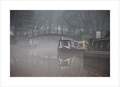 Bicycles and Barges (Explore 13/01/17 #48) (andyrousephotography) Tags: worsley packethouse narrowboats barge barges bridgewater canal cyclist bicycle bike rider iron footbridge mist misty fog damp water still andyrouse canon eos 5d mkiii