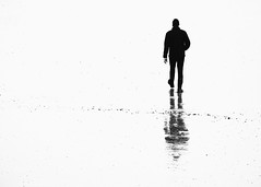 Into The Unknown (Fourteenfoottiger) Tags: stark story abstract adventure unknown space negativespace mystery walk walking beach candid man person figure mono monochrome blackandwhite highcontrast steps reflections shadow silhouette