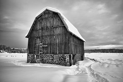old barn, more snow (twurdemann) Tags: agriculture architecture barn blackandwhite building canada clouds farm field fujixt1 horses niksilverefex northernontario oldgardenriverroad ontario rural saultstemarie sky storage weathered xf14mm