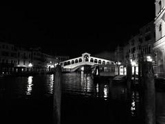 Rialto Bridge At Night (updownmo) Tags: wood windows arches streetlights reflections boats buildings water phonecamera photography bw bridge venice architecture nightbridge nightphotograph