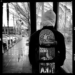 Out of the rain (Chris Blakeley) Tags: seattle hipstamatic candid rain bnw skateboard antihero busstop bw streetphotography