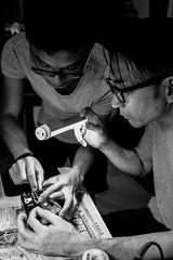photographers fd repair X100S at home . (yipsinclair) Tags: city urban bw monochrome hongkong blackwhite streetphotography snap fujifilm x100t fujixphotography