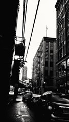 Wabash Ave. The Loop. (williamw60640) Tags: blackandwhite chicago streetlights traintracks citylife powerlines fireescape theloop flagpole urbanscape elevatedtrain urbanlife cityscenes wabashave