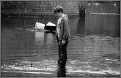 Quandry (* RICHARD M (Over 5 million views)) Tags: street wet water mono blackwhite flood candid teen teenager wtf adolescent highwater southport floods uhoh botanicgardens whatnext flooded marooned merseyside quandry nowwhat adolescense wetfeet churchtown wetpants wetjeans anotherfinemess wettrousers troubleinstore
