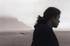 Dabao 42, Hobbit Beach 2016 (Sara J. Lynch) Tags: sara j lynch dabao hobbit beach black white asahi pentax k1000 35mm film ocean sand headlands ponytail profile portrait beautiful friend oregon