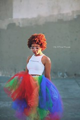 Sun-kissed and Rainbow Clad (Kelly McCarthy Photography) Tags: woman model beautiful beauty fashion style colorful rainbow tutu croptop glasses whiteglasses whiteframes sunlight naturallight glitter outdoors urban catchycolorsred catchycolorsblue catchycolorsgreen skirt retro mod choker