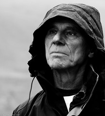 Some people walk in the rain, others just get wet. (Neil. Moralee) Tags: neilmoralee svalbardnorwaylongyearbyenneilmoralee man rain raining wet good coat shadow storm face portrait candid black white mono bw blackandwhite monochrome nikon d7100 neil moralee old mature wrinkled outdoor soaking waterproof water damp drizzle downpour people