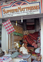Supreme Matresses (cowyeow) Tags: street city travel sleeping people india man sign shop retail composition asian store asia candid painted indian goods business mumbai mattress funnysign bedding paintedsign mattresses colaba funnyindia