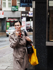 smoking in the rain (matthewheptinstall) Tags: city portrait urban woman rain cigarette candid documentary smoking wakefield smoker westyorkshire tolet rainmac