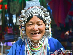 2015-11f Akha (11) (Matt Hahnewald) Tags: world travel colour tourism face smiling closeup female person photography one eyecontact asia adult culture streetportrait tribal headshot grinning oldwoman ethnic cultures goldentriangle ethnology northernthailand ethnicminority badteeth 43aspectratio worldcultures traveldestination maesalong ethnicportrait akhavillage ethnotourism thaihilltribe silvercoins akhawoman stringsofbeads facingtheworld nikond3100 nikkorafs50mmf18g traditionalakhacostume akhaheaddress matthahnewaldphotography