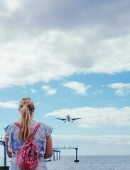 Mind Your Head! (Conor Price) Tags: lanzarote arrecife airport plane fujifilm fujifilmxt10 xt10 fujixt10 fujifilm35mm14 35mm14 f40 35mm mirrorless girl woman wife holiday runway beach sky clouds bag