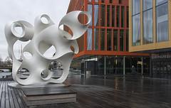 play music - do politics - make art (lunaryuna) Tags: sweden malmo city urban walkinthecity urbanconstructs architecture modernarchitecture colours modernart sculpture artinpublicspaces rivershore woodendeck lunaryuna
