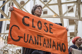 "Helen Schietinger Holds a ""Close Guantánamo"" Banner Inside Trump International Hotel"