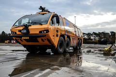 Washing off the Dirt (Floris M. Oosterveld) Tags: woensdrecht fire rescue training center royal netherlands air force department eone crash tender rnlaf klu big machine washing reflections after action cleaning sunset