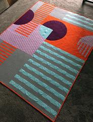 Urban Trek Quilt (Quiltachusetts - Heather Black) Tags: modern quilt contemporary geometric walking foot solids curve piecing stripes texture grey orange purple aqua burgundy throw