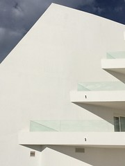 Sun on a stormy day (markshephard800) Tags: playablanca lanzarote shadows light balconies white glass angles abstract canaries canarias hotel modernism modern architecture